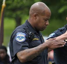 An American police officer paying homage to Allah