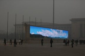 BEIJING, CHINA - The LED screen shows the blue sky on the Tiananmen Square at dangerous levels of air pollution on January 23, 2013 in Beijing, China. (Photo by Feng Li/Getty Images)