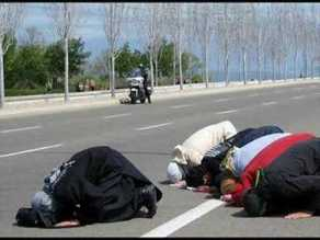 Bowing to Allah. They do this three times a day, where ever they are.