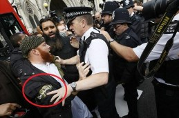 A young Brit who has joined the Mujahid in London, and wears an armband to signify which team he is on.
